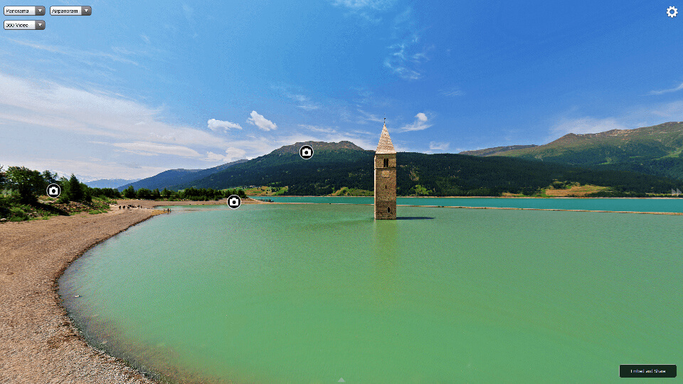 lake-reschen-mountains-church- tower